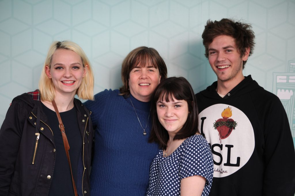Members of the band Cherry Glazerr (from left, Clementine Creevy, Hannah Uribe and Sean Redman) with KCRW host Chery Glaser.