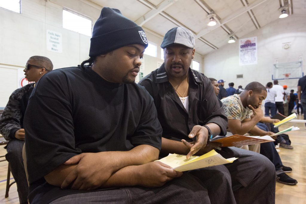 Omari Burrell (left), 27, an aspiring actor and hip hop artist rehearses his lines for the role of Ice Cube as he awaits to audition.