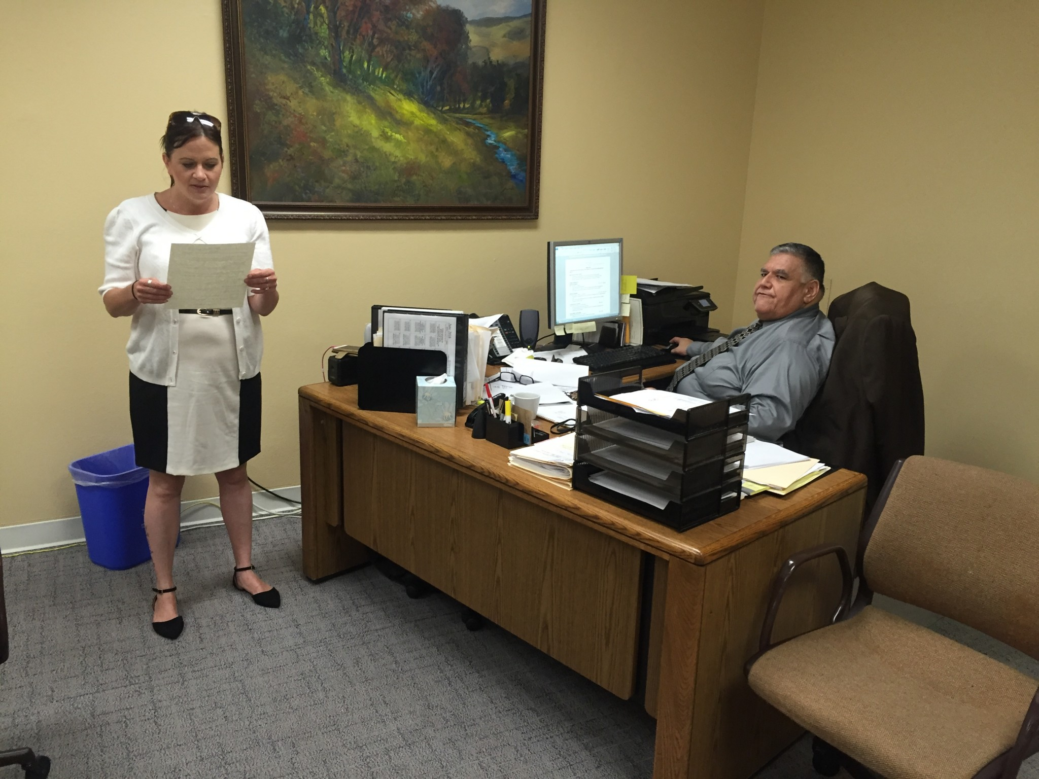Dawn with Ricardo Medina, a staff member at the L.A. Mission, going over her resume