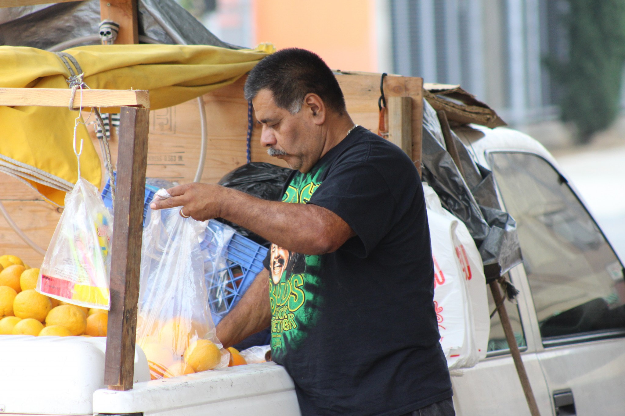 Estaban Romero in front of his truck. He sells fruit to make ends meet, while he hopes for his $16,000 wage claim to result in back pay. (Photo: Karen Foshay)