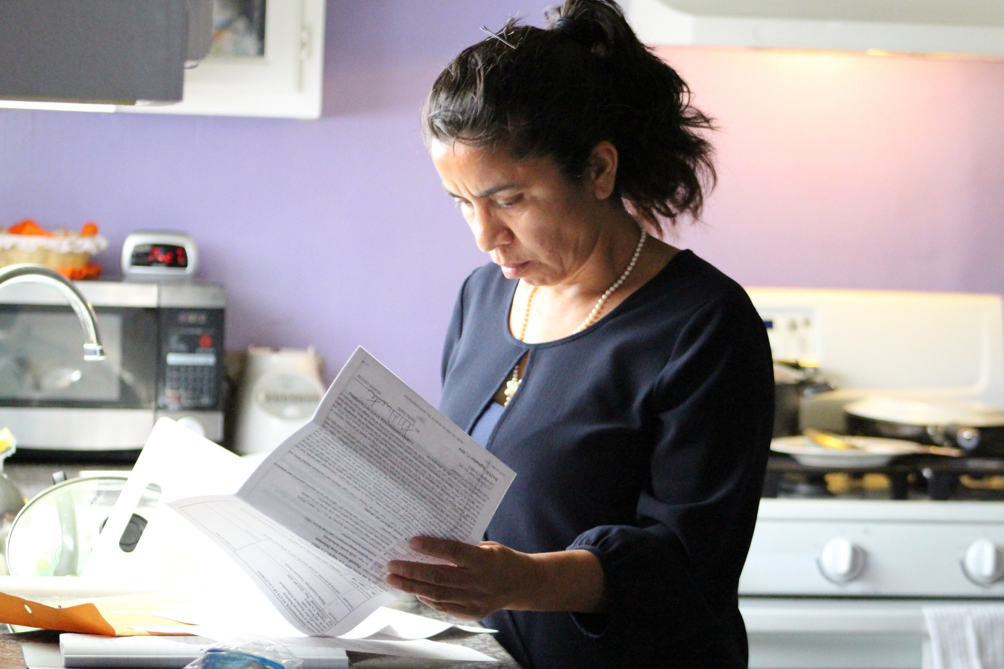 Maria Vazquez reviews her recent award of over $1.4 million in her sexual assault and wage theft lawsuit against her former employer. So far, she hasn't collected on any of it. (Photo: Karen Foshay)