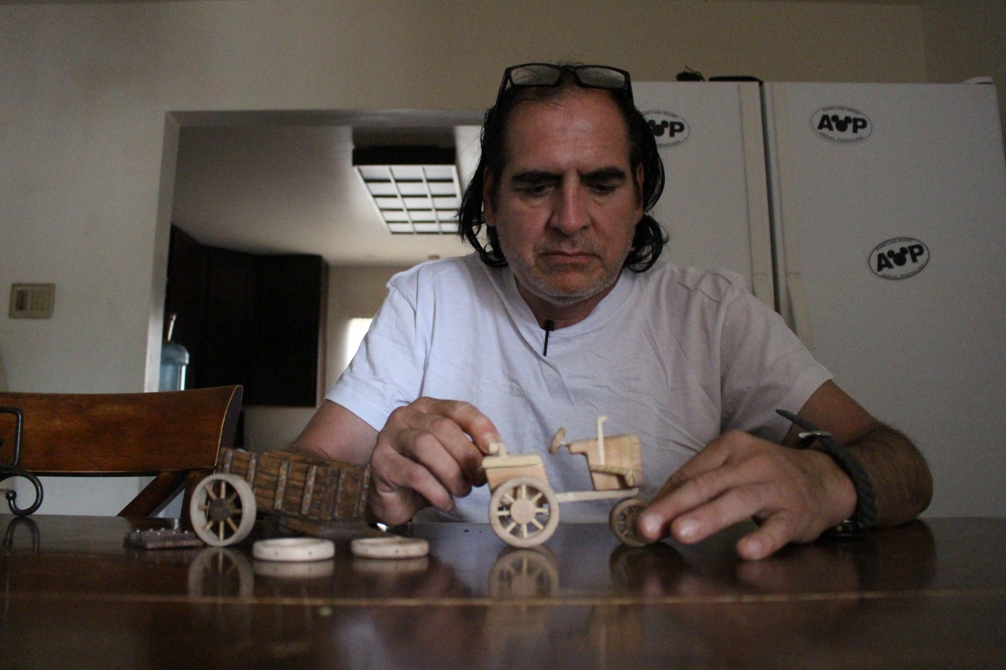 Alex Sanchez makes small wooden toys, which he gives to his doctors. (Photo: Karen Foshay)