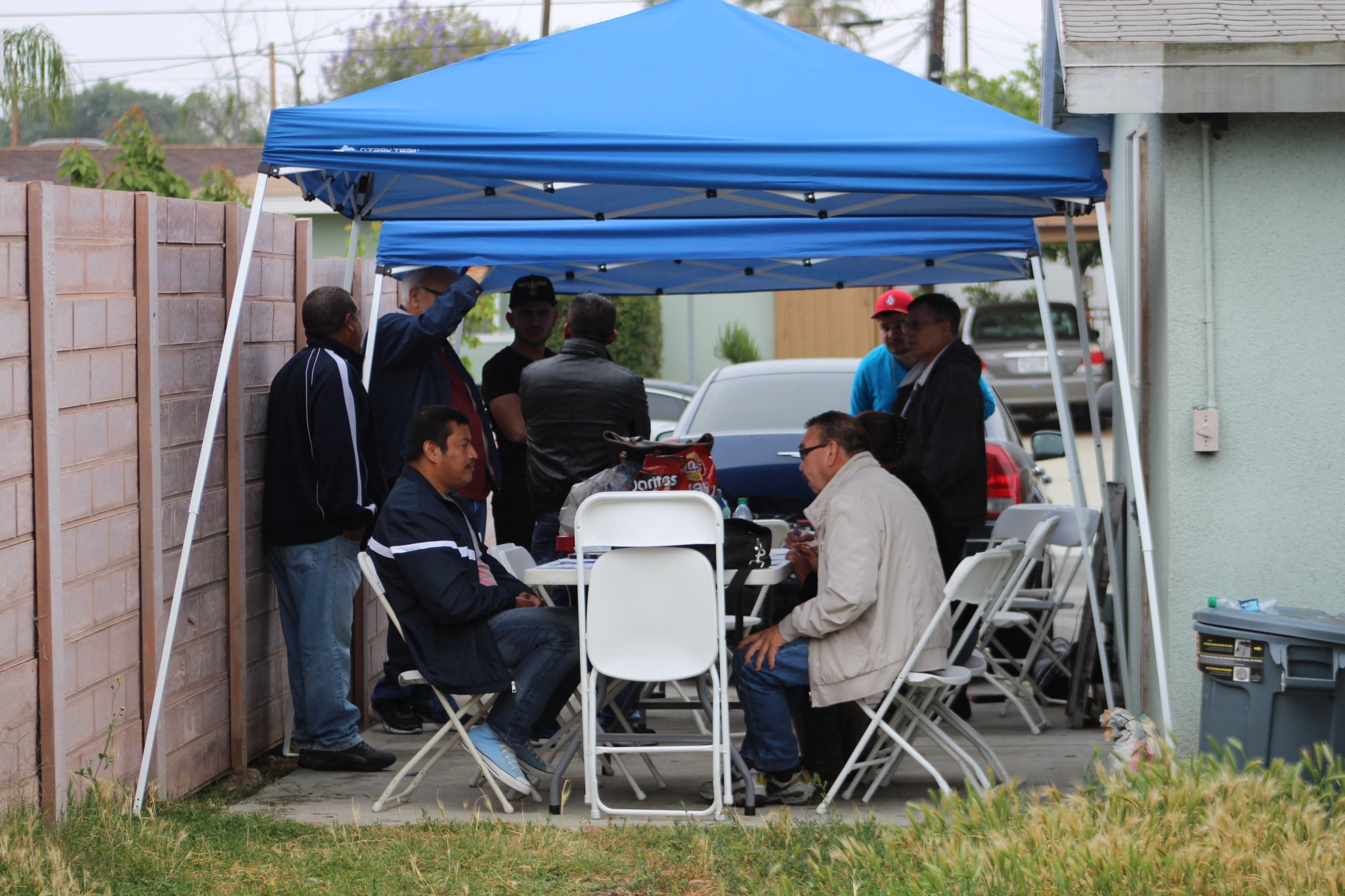A group of workers gather to get help with wage claims. (Photo: Karen Foshay)