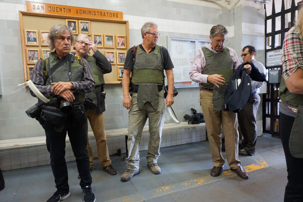 Journalists wearing knife-resistant vests go through a security checkpoint on the way to California's death row facilities. Photo: Saul Gonzalez