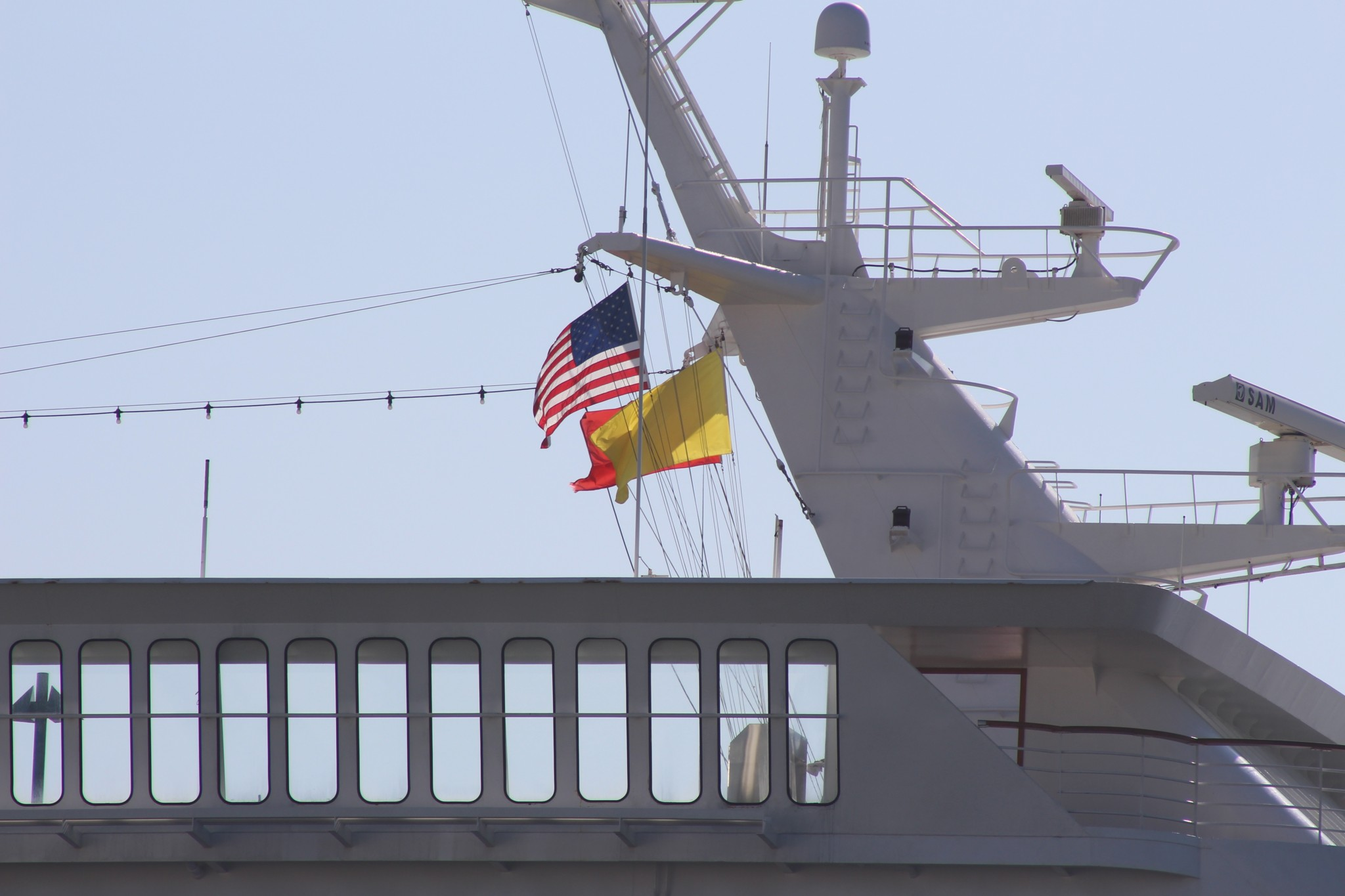 A ship flies several flags at the Port of Long Beach. Photo: Karen Foshay