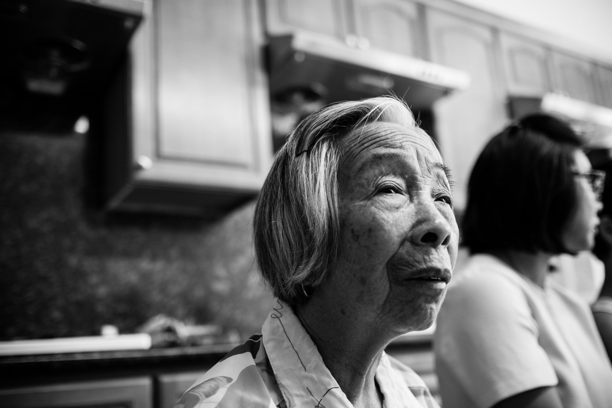 All of the senior tenants, several of them in their mid-to-late 80s, like Mrs. Wong, have lived in this building for 15 years or more. They are all immigrants, and speak little English. They also say they don't want to move regardless of how much money they might be offered to do so. (Photo by Bear Guerra)