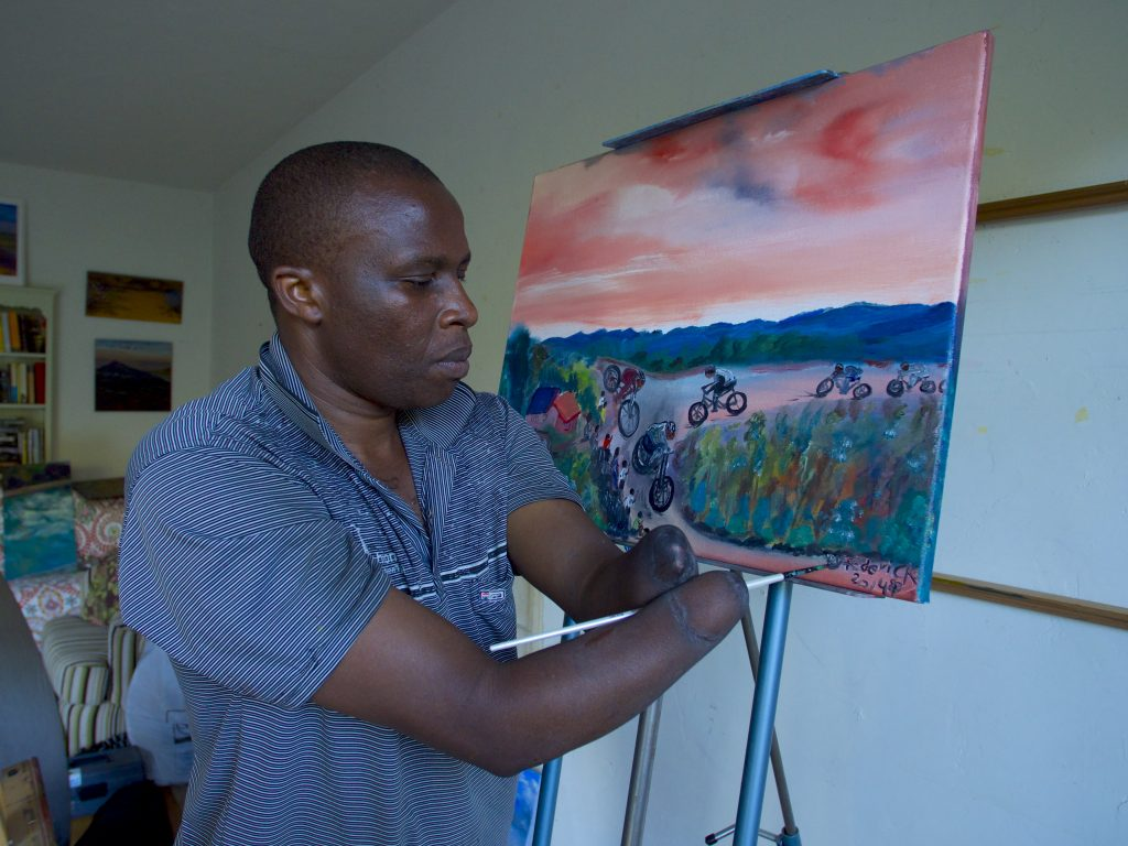 "Frederick Ndabaramiye painting his story at the Shelton Studio in Montecito, CA."" Photo: Pedal Born Pictures"